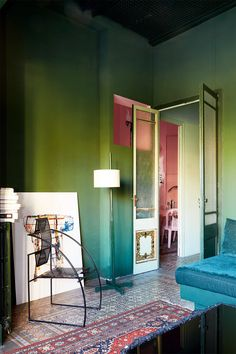 Gravity Home: Green Living Room in A Colourful Designer's Home in Barcelona