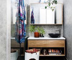 Modern bathroom with patterned towels and timber vanity