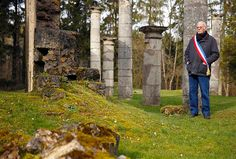 Charles Saint-Vannes, 77, the mayor of Ornes, poses for a photograph in the remains of the village church near Verdun.