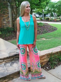 We are so in LOVE with these palazzo pants! The colors are vibrant but beautiful and grab everybody's attention immediately! The silky material fits like a glove and the style of these cuties is right