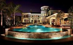 Great mansion house with a grand, illuminated pool. Who can't resist this amazing beauty? I love the stone exterior of the pool.