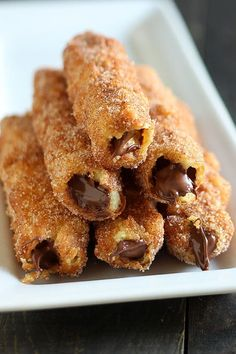 Homemade Nutella-stuffed churros get deep-fried, coated in cinnamon sugar, and packed with Nutella filling. A must-have dessert!