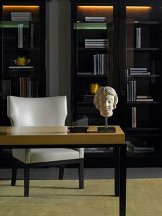 Library/Home Office - Love the in cabinet lighting with tinted glass doors, white leather chair & stylish desk. Decor, Interior, Interior Inspiration, Home, White Leather Chair, Office Interiors, House Interior, Stylish Chairs, Stylish Desk