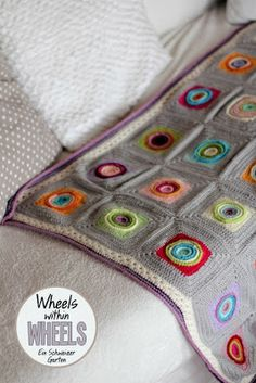 "Ein Schweizer Garten: Crochet-Love Pattern ""wheels within wheels""  Crochet blanket in grey"