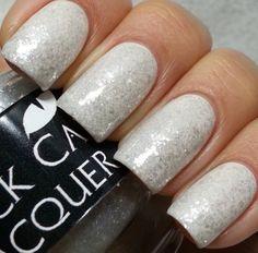 "Black Cat Lacquer ""Selenite"" over white polish"