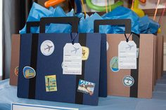 Suitcase goody bags for airplane themed birthday party.