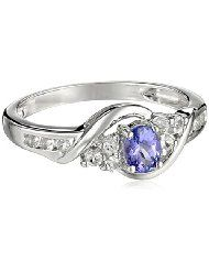 10K White Gold Oval Tanzanite and Round White Topaz Ring, Size 7  $150.19