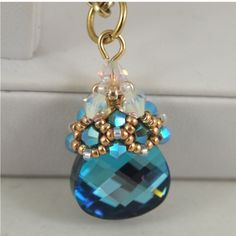 Another of Sidonia's Youtube videos for a crystal beadcap: http://youtu.be/tBgVHLcKDSg?list=UU7H4DLu9AuBlqyYdHw9pIoA