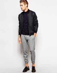Shop this look on Lookastic:  http://lookastic.com/men/looks/navy-turtleneck-charcoal-bomber-jacket-grey-sweatpants-burgundy-tassel-loafers/9883  — Navy Turtleneck  — Charcoal Bomber Jacket  — Grey Sweatpants  — Burgundy Leather Tassel Loafers