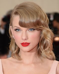 The 25 Best Beauty Trends of All Time: Red Lips (Pictured: Taylor Swift) | allure.com