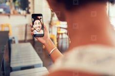 85da32fe43c Photos - Woman having a video call with man on her smart phone -  YouWorkForThem