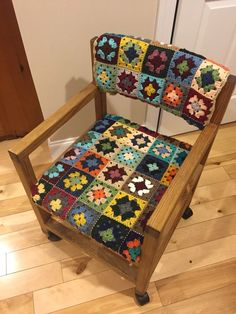Mom crocheted a cover for her chair by using granny squares. Gave the chair a new look!: