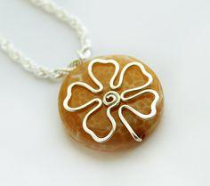 Silver Flower Fire Agate Pendant. $25.00, via Etsy.