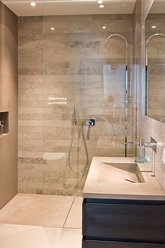 shower tile has same colour tone as floor but also some variation to create a feature wall.