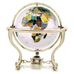 The Opal Gemstone Globe with Commander Gold Stand is a great choice for a decorative globe. Manufactured with some of the best quality semi-precious gemstones you will not be disappointed by the layout and presentation of this design. #floorstandingglobes #rotatingglobes #papwerweightglobes #Kalifanobookendglobes #gemstoneglobes #worldglobes