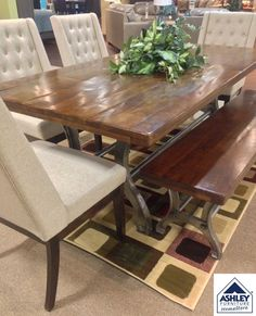 """Industrial-chic style that's quite a conversation piece. Ranimar dining room table elevates the look and feel of loft living with a thick plank tabletop crafted of solid wood. Its rich, rustic finish really captures the essence of """"reclaimed"""" lumber."""