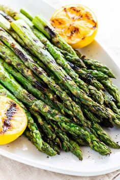 Grilled asparagus makes charred spears with smoky flavor and lightly crisp edges. It's seasoned with olive oil, salt, pepper, and served with lemon. #asparagus #grilledasaparagus #bbq #grilling Grilled Asparagus Recipes, Lemon Asparagus, Chicken Asparagus, How To Cook Asparagus, Balsamic Dressing, Lemon Sauce, Grilling Recipes, Summer Recipes, Healthy Choices