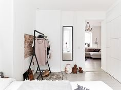 white walls with brick, clothing rack//future home