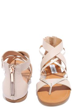 "You'll be ""honored"" to make the acquaintance of our Steve Madden Honore Blush Leather Thong Sandals! Smooth blush and metallic genuine leather straps cross over a thong upper to meet a structured heel cup with 3"" zipper (and rose gold pull!)."