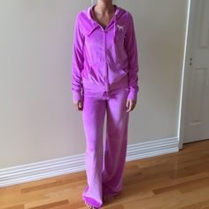 NWOT PINK Victoria's Secret velour outfit Rare velour outfit in a pinky purple color. NWOT. Bottoms are XS and jacket is a S. You will not be disappointed with this  PINK Victoria's Secret Tops Sweatshirts & Hoodies