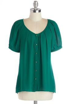 Love the color and the few small pleats at the neckline.