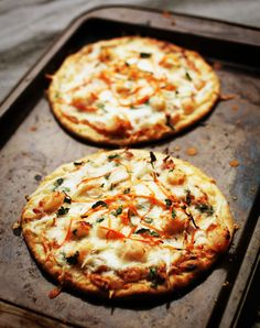 This easy Thai Shrimp Pizza recipe uses a savory sweet peanut sauce base and uses shrimp, bean sprouts, cilantro, and shredded carrots as its topping. Must make this stat!