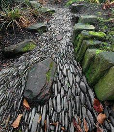 Another wonderful example of a dry river bed .. I love how the stones laid on their sides gives the illusion of running water.