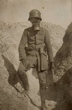 Ww1 german storm trooper poses in the trenches with gas mask and