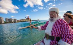 Only in Hawaii: Watch Santa Make a Visit by Canoe | Santa ditches his sleigh when in Waikiki.