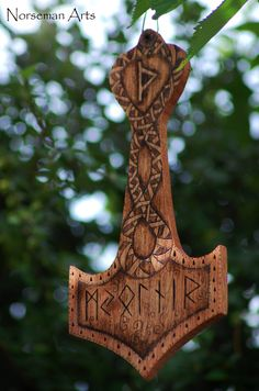 Mjolnir carved of wood from Norsemen Arts