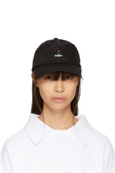 0c71bf4b0c2 Cotton twill cap in black. Eyelet vents at crown. Logo graphic embroidered  at face. Tonal cinch strap at back. Available exclusively at SSENSE.