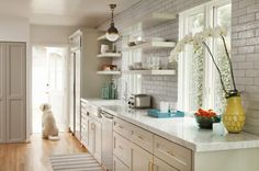 Glossy light gray cabinets, open shelving, subway tile... perfect