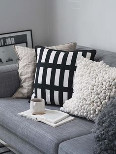 Sustainable cushions and home accessories from Happy + Co Scandinavian living room - monochrome
