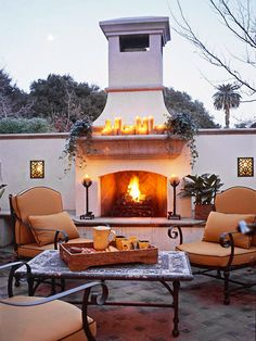 Add coziness to your patio with an outdoor fireplace. More fabulous fireplace ideas: http://www.bhg.com/home-improvement/porch/outdoor-rooms/fabulous-outdoor-fireplaces/?socsrc=bhgpin0514127=7
