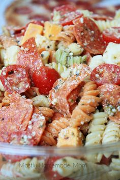 This Pepperoni Pizza Pasta Salad features tri colored rotini pasta with pepperoni, mozzarella, cheddar, and tomatoes in a Parmesan vinaigrette. This Italian pasta salad variation is the perfect summer side dish recipe! Pepperoni Pasta Salads, Pizza Pasta Salads, Pasta Salad Recipes, Pasta Dishes, Food Dishes, Recipe Pasta, Pepperoni Recipes, Kid Pasta Salad, Recipe Box