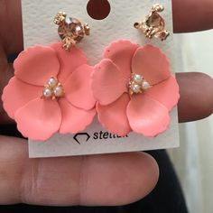 NWT. Pink flower earrings Adorable pink flower ratings! I bought these when I lived in Japan, but never had the occasion to wear them. Jewelry Earrings