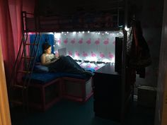 Growing up I always wanted a loft bed and cozy seating under it. Love this!