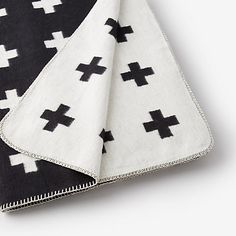 This large cross blanket is a the perfect way to provide a little graphic to a space and is a stylist favorite. Designed by Pia Wallen, this organic cotton blanket is a frequently featured item in magazines and design blogs. We love it too! In swedish folk art tradition, the cross is a strong symbol for hope, and it has become a signature motif for Pie Wallen - Shop Talk: Our Designer Favorite from Steven Alan
