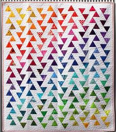 Lombard Street - Quilt Pattern $9.50 This is easy: horizontal rectangles with a 60 degree triangle of color in each one - each row offset by half the height of the rectangle