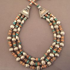 India   Silver, amber, coral and other semi precious stones   This type of traditional necklace is typical from north of India (Himachal Pradesh)… these semi precious stones (turquoises, coral, amber…) are appreciated for their healing and protective virtues   © Michel Halter.