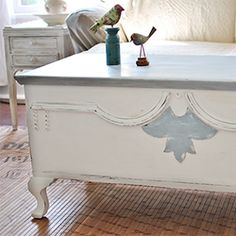 An old blanket chest with detailed trim gets a new life with Annie Sloan Chalk Paint in Louis Blue and Pure White.