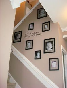 Random hanging of pictures on a staircase wall