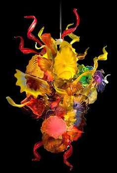 Chihuly glass - my city's fortunate to have an absolutely outstanding piece of his work here as a permanent museum fixture - you can view its enormity from the ground floor and stand atop it one floor up - amazing!