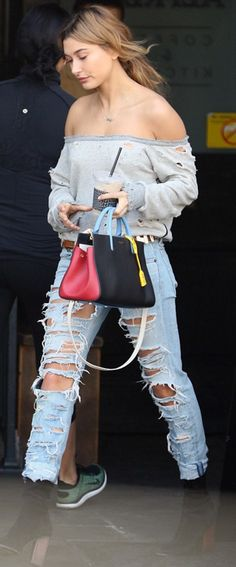 Who made Hailey Baldwin's gray ripped sweatshirt, black boots, and handbag?