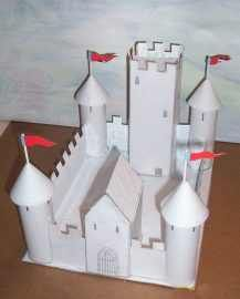 cardboard castle made out of cereal boxes and toilet paper and paper towel rolls...it all fits on a 8.5X11 sheet of paper so not too time consuming either...this is still unpainted so get creative and let the kids have some medieval fun