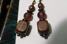 Copper and wooden bead dangle earrings with frosted purple beads #design #gifts
