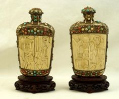 "unusually-large-19th-c-sino-tibetan-snuff-bottles-	embellished with coral & turquoise over 100 year old carved bone/ivory approx 7"" tall on carved rosewood stands"