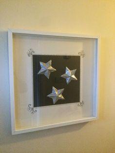 Tinfoil stars in Ikea frame