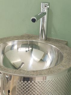 Upcycled washing machine drum makes a fancy wash basin by www.robcollyer.com
