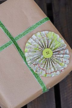 How To Make Paper Rosettes Decorations From Old Maps - Pillar Box Blue Diy Furniture Projects, Cool Diy Projects, Craft Projects, Paper Rosettes, Paper Flowers, Road Maps, Map Crafts, Thrift Store Crafts, Gift Wrapping